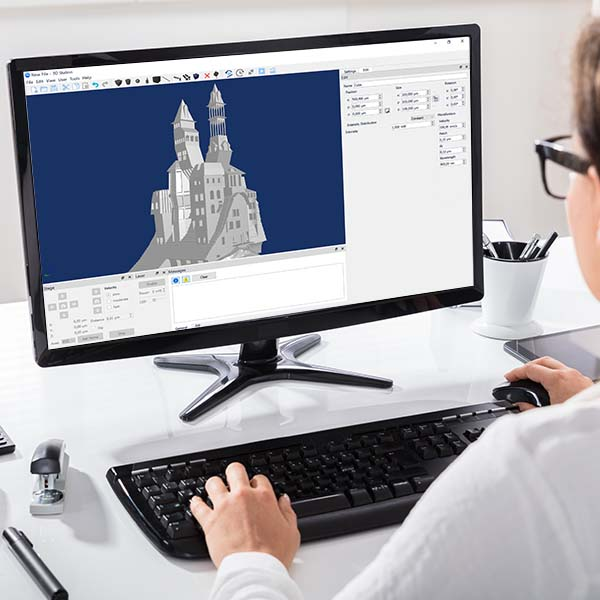 Photo: person working modeling a 3D castle on an computer using THINK 3D software