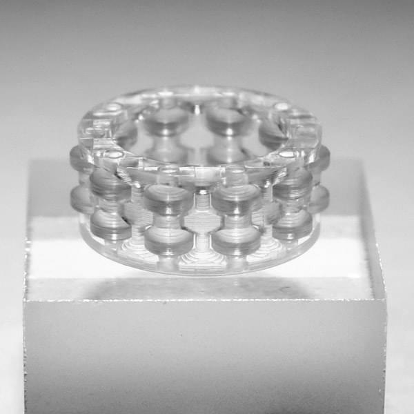 Photo: shiny roller bearing on a glass substrate