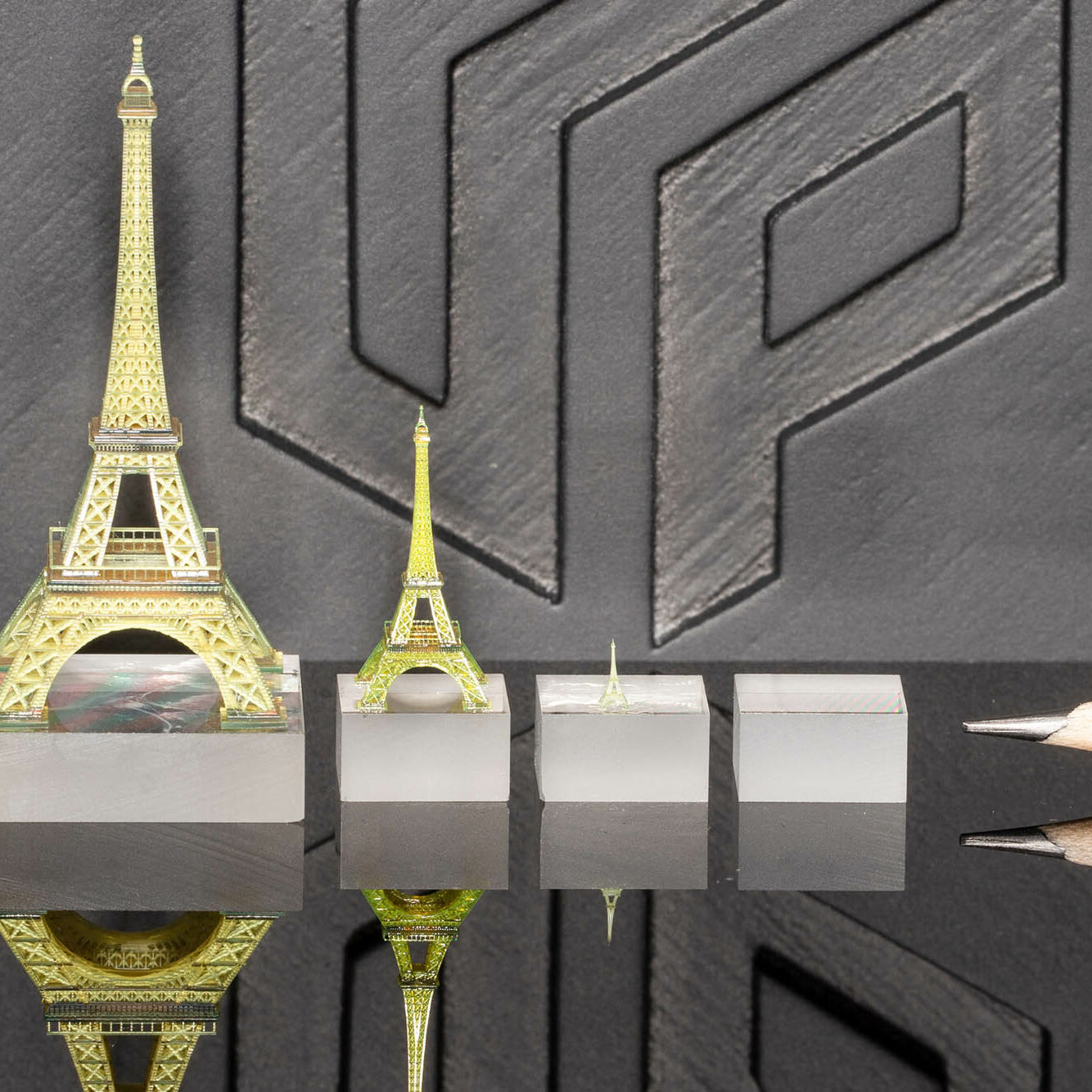 Photo: miniature models of Eiffel Tower in three sizes