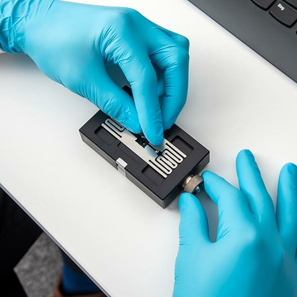 Photo: hands in gloves placing a substrate on an substrate holder